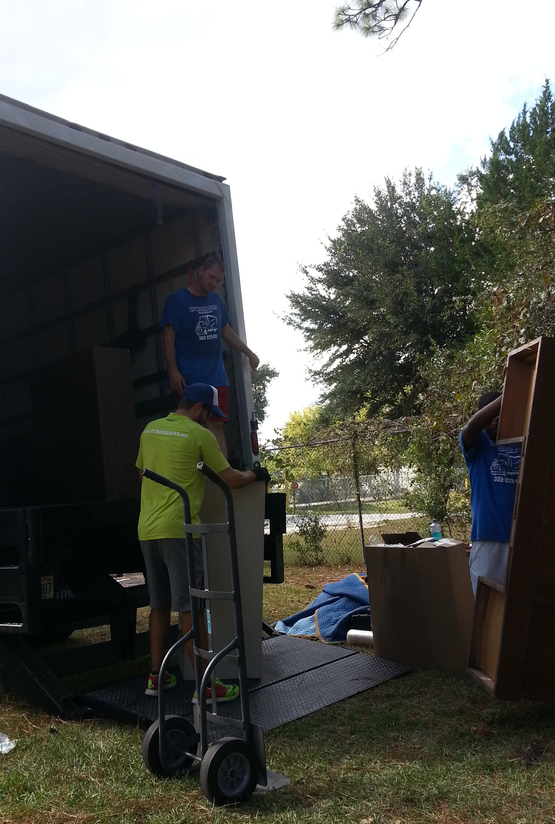 Here, Stan Travis and Kenny unload the items going into the new building.
